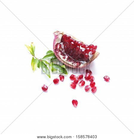 A piece of pomegranate with seeds on a white background