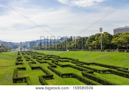 Eduardo VII Park in Lisbon, Portugal, decorated with hedges. View of the city center and downtown from the scenic overlook or vista point built on the top.