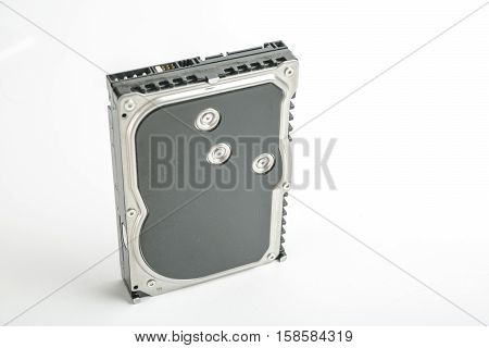 Black and silver desktop 3.5 inch hard disk. The disc has a vertical position, SATA connector upwards. Isolated on white background.