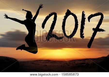 To Celebrate The New Year 2017 Silhouette Of Young Woman Jumping On The Beach