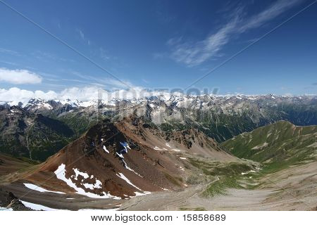 Mountain rocky ridge against blue sky in Caucasus