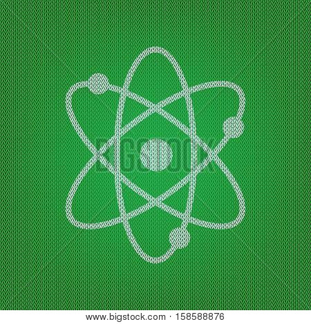 Atom Sign Illustration. White Icon On The Green Knitwear Or Wool
