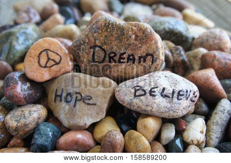 Peace Sign, Dream, Hope and Believe Written on River Rock