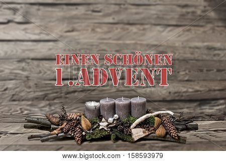 Merry Christmas decoration advent with burning grey candle Blurred background text message german 1st