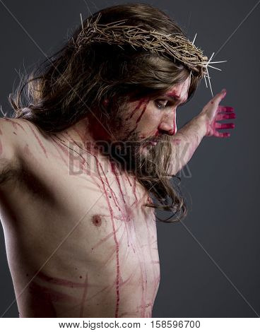 Jesus christ, jesus of nazareth with the crown of thorns and blood for his body as penance before the crucifixion