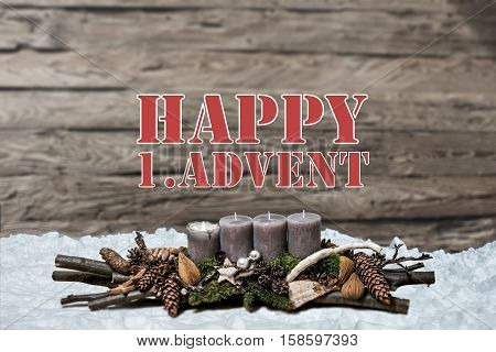 Merry Christmas decoration advent with burning grey candle Blurred background snow text message english 1st