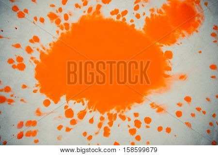isolated large patches spots blots of splash Orange colors. Orange Ink Conveyed Over White Close-up Paper. Abstract Background. Ink Orange Stains Spread Out and Absorbed Into the Paper Macro.