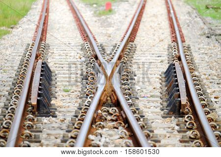 Line of railroad junction in Thailand. In closeup.