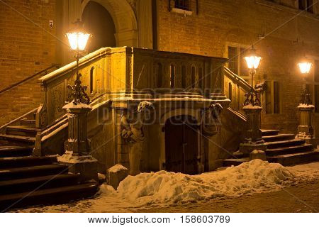 The main staircase of the historic building on Long Market (Dlugi Targ) street in night. Gdansk is a Polish city on the Baltic coast and popular center of tourism.
