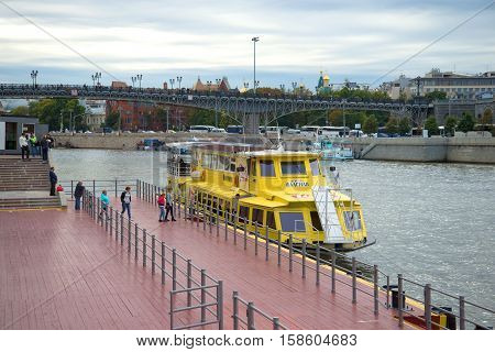 MOSCOW, RUSSIA - SEPTEMBER 07, 2016: Landing of passengers to the walking motor ship to a water excursion across the Moskva River