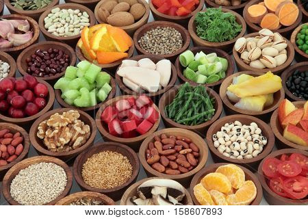 Healthy super food collection in wooden bowls. High in antioxidants, vitamins, minerals and anthocyanins.