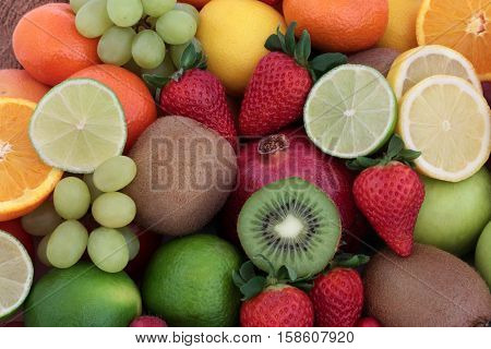 Large fresh fruit background with fruits high in antioxidants, vitamins, anthocyanins and dietary fiber.