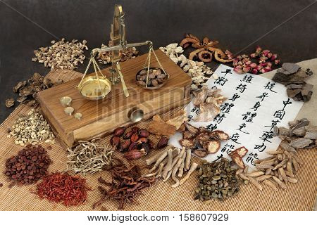 Chinese herbal medicine with herbs,  scales and calligraphy. Translation reads as chinese herbal medicine as increasing the bodys ability to maintain body and spirit health and balance energy.