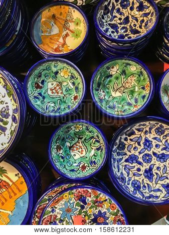 Moroccan handmade crockery. Plenty of decorative handmade bowls and plates displayed in a souvenir s