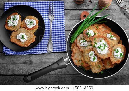 Composition with tasty potato pancakes for Hanukkah on wooden table