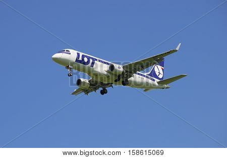 SAINT PETERSBURG, RUSSIA - JUNE 29, 2015: Aircraft LOT Polish Airlines Embraer E-170 (SP-LIN) before planting