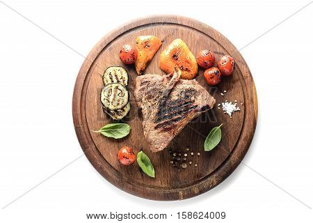 grilled beef steak on a cutting board on a white background