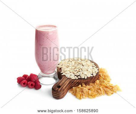 Fresh raspberry milkshake with oatmeal and corn flakes isolated on white