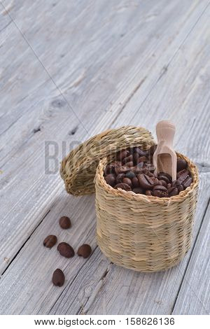 Vintage cup with coffee beans on a vintage white wood table