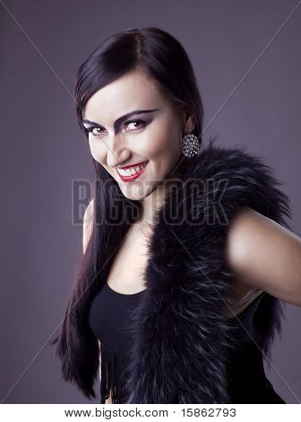 Beauty woman smile in fur boa - retro make-up