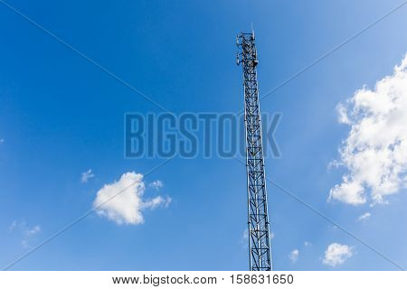 The top of communications tower with blue sky background.