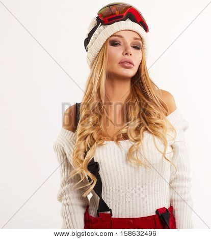 Woman skier girl wearing warm clothing ski googles portrait. Winter sport activity. Beautiful sportswoman