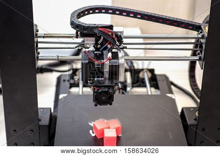 printer and printed models cubes three pieces