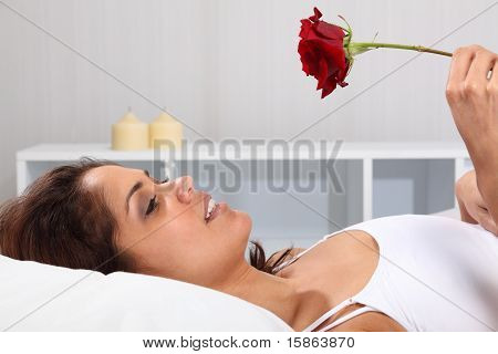 Gift of a rose in bed