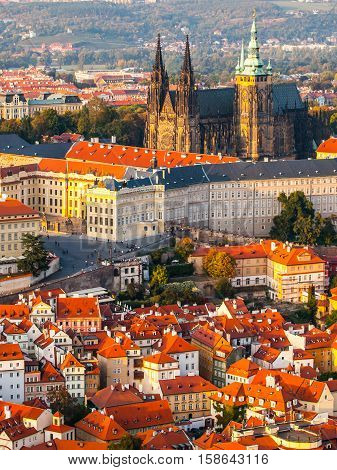 St Vitus Cathedral - landmark of Prague Castle historical complex. Aerial view from Petrin Hill Lookout Tower in the evening sunset time. Prague capital city of Czech Republic, Europe. UNESCO World Heritage Site