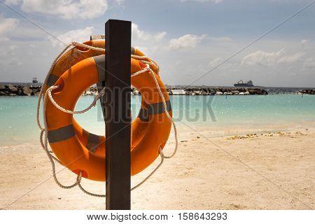 Lifebuoy on a sea background - beach season