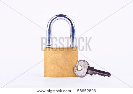 old brass padlock and key on white background tool isolated