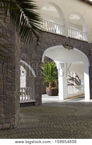 Arch entrance group with balcony and railings
