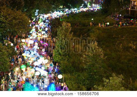 ATLANTA, GA - SEPTEMBER 2016:  Motion blur of hundreds of people walking with lanterns at night along the Beltline in the annual Atlanta Lantern Parade in the Old Fourth Ward in Atlanta GA on September 10 2016.