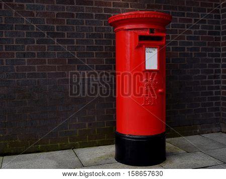 Red vintage mailbox in Birmingham city center