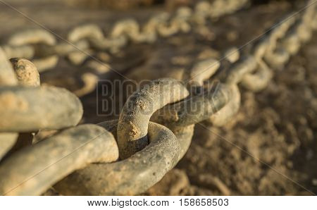 Close-up of links of a long iron chain in detail