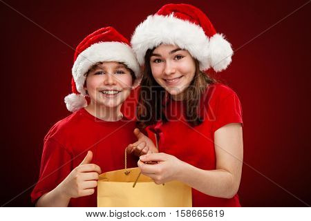 Christmas time - girl and boy with Santa Claus Hat