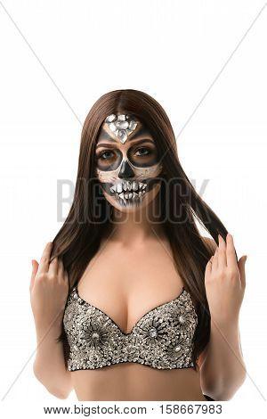 Santa Muerte. Pretty brunette with creative face art