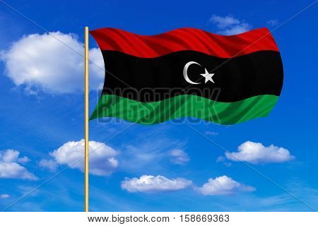 Libyan national official flag. African patriotic symbol banner element background. Correct colors. Flag of Libya on flagpole waving in the wind blue sky background. Fabric texture. 3D rendered illustration