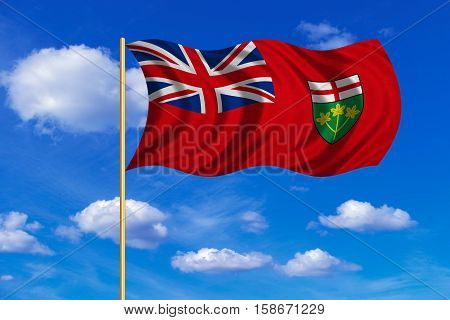 Ontarian provincial flag patriotic element official symbol. Canada banner. Correct color. Flag of the Canadian province of Ontario on flagpole waving in the wind blue sky background. Fabric texture. 3D rendered illustration