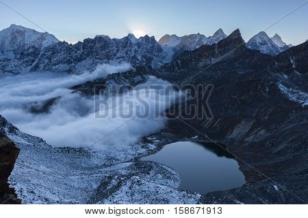 Small Moraine Lake And Snowy Mountain Peaks In The Early Morning Lights In Himalayas, Nepal. Mirror