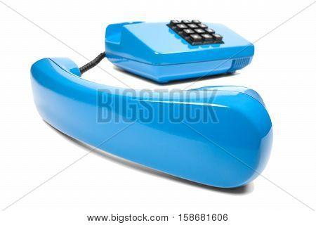 Blue landline phone on isolated white background