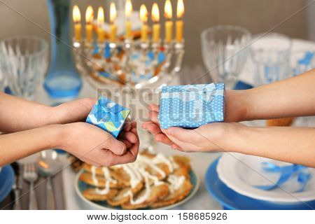 People giving presents for Hanukkah to each other, closeup