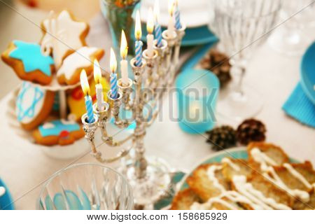 Close up view of menorah on table served for Hanukkah