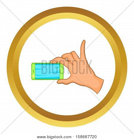 Hand holding mobile phone vector icon in golden circle, cartoon style isolated on white background