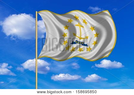 Flag of the US state of Rhode Island. American patriotic element. USA banner. United States of America symbol. Rhode Islander flag on flagpole waving in the wind blue sky background. Fabric texture. 3D rendered illustration