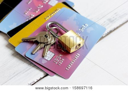 Credit cards with lock close up - online shopping on wooden background