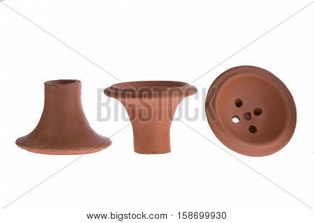 hookah bowl for tobacco shisha brown pottery, three ceramic products with five holes, three brown clay vessels in the shape of mushroom, one vessel stands right and second reversed and third lays