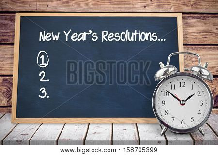 New years resolution list against composite image of black board