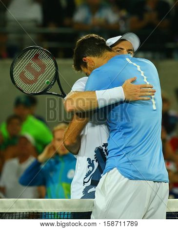 RIO DE JANEIRO, BRAZIL - AUGUST 14, 2016: Juan Martin Del Potro (R) congratulates Olympic champion Andy Murray of Great Britain with his victory at men's singles final of the Rio 2016 Olympic Games