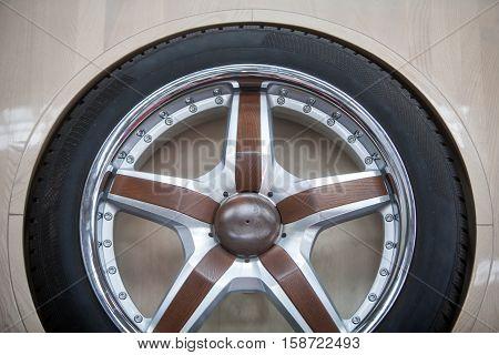 Close up shot of a new wooden car rim.
